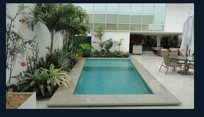 47 fotos de paisagismo para piscina e jardim residencial for Jardim na piscina